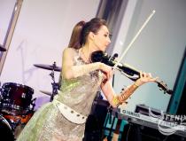Скрипачка на праздник в Москве. Церемония награждения почётных граждан стран Таможенного союза 13 декабря 2015 в Москве
